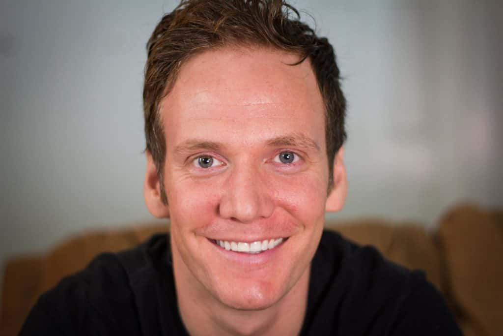 A close up of a man smiling for the camera, with Dane Maxwell